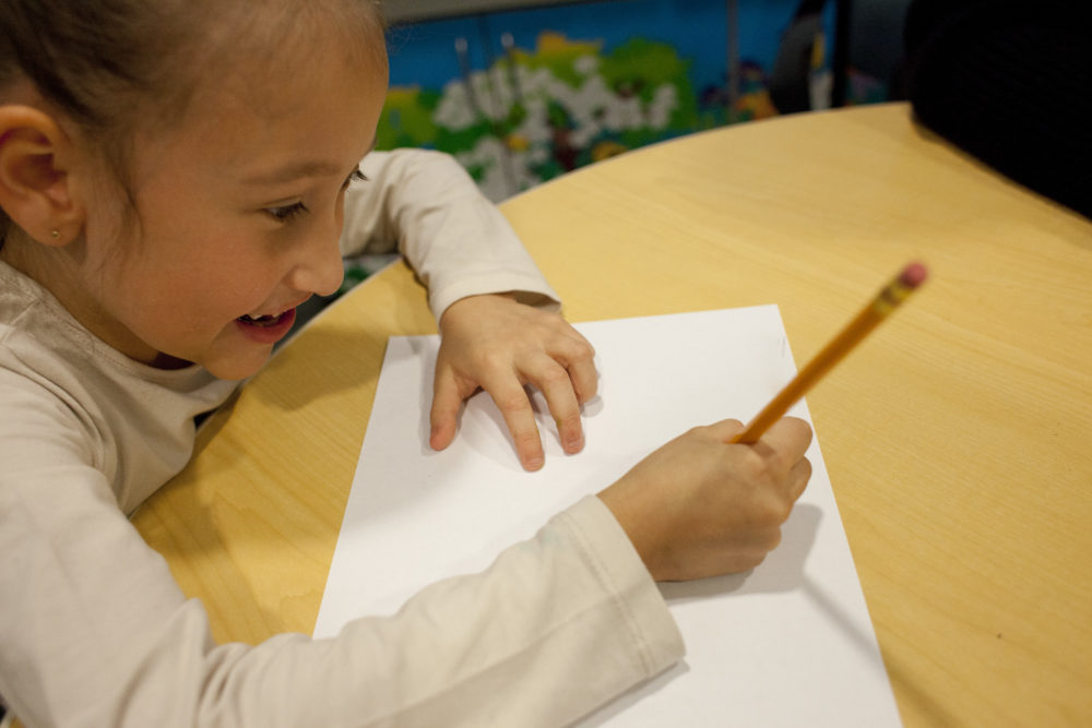 a picture of a child writing