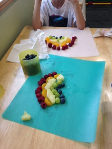 fruit aligned like a rainbow