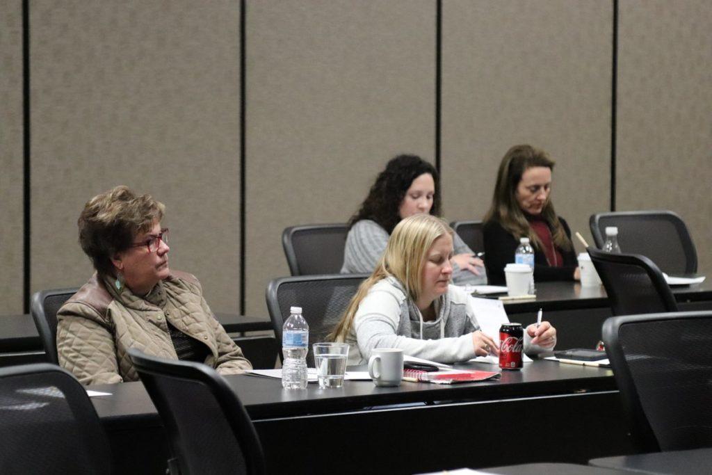 several women listen to a speaker