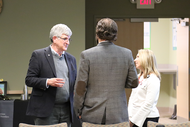 Dr. Offit speaks with two Thompson Center faculty members