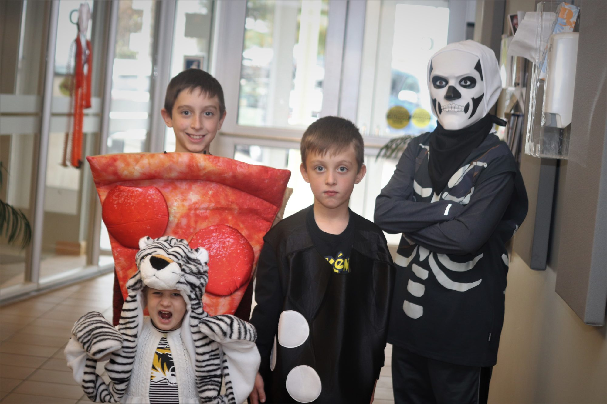 five kids in costumes