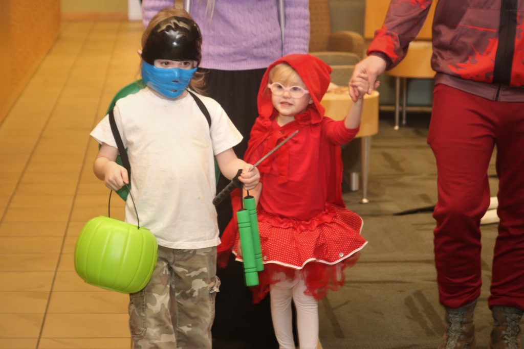 a boy in a ninja costume and a girl in a little red riding hood costume