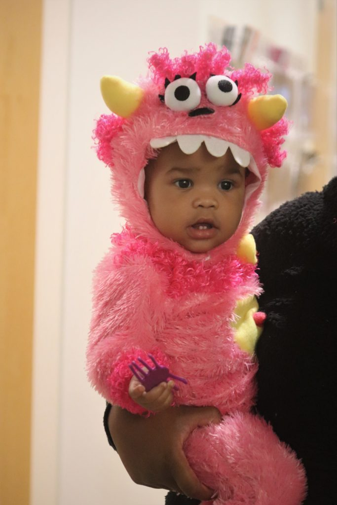 baby in pink costume