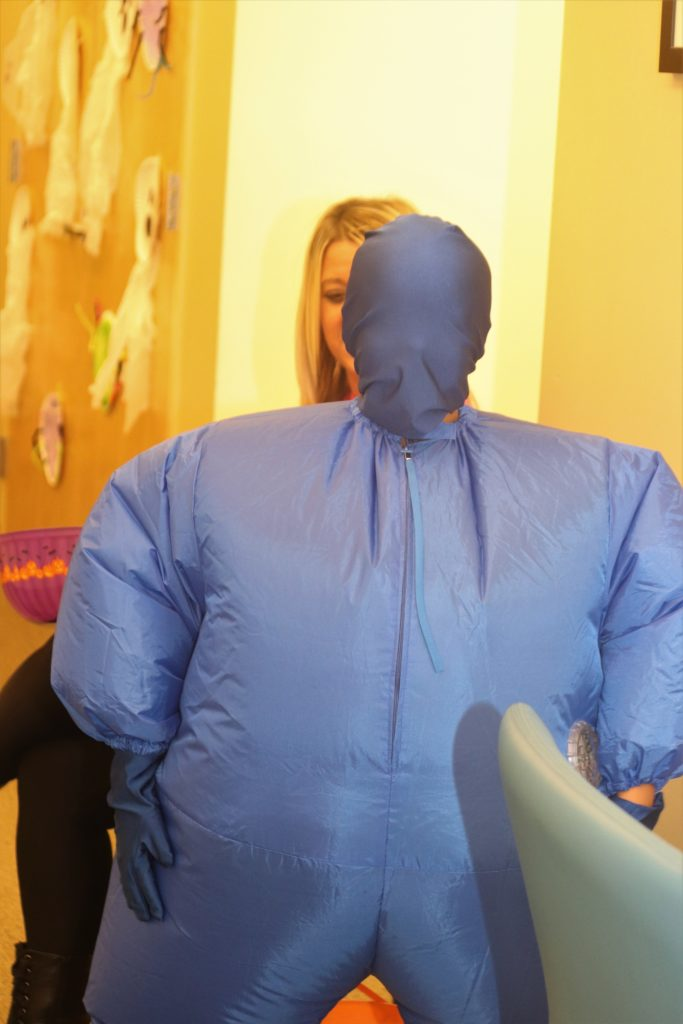 boy in inflatable blue costume
