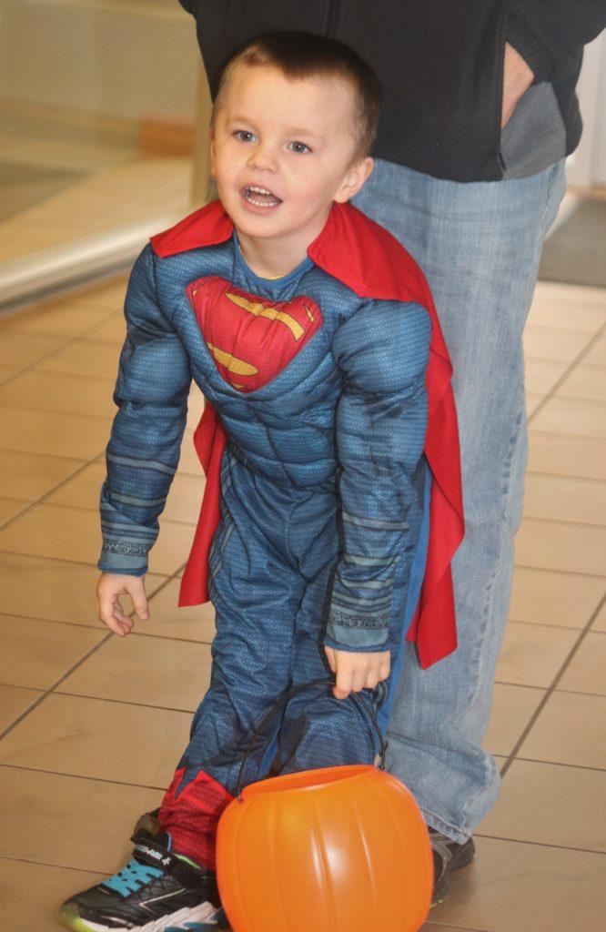 child in superman costume