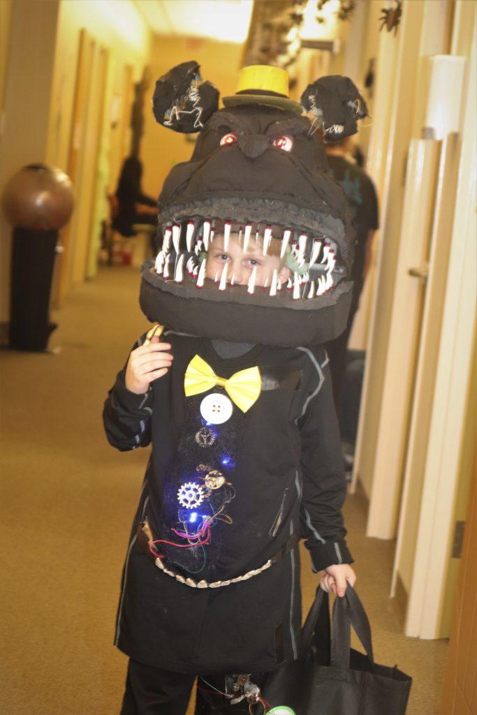 child in monster costume