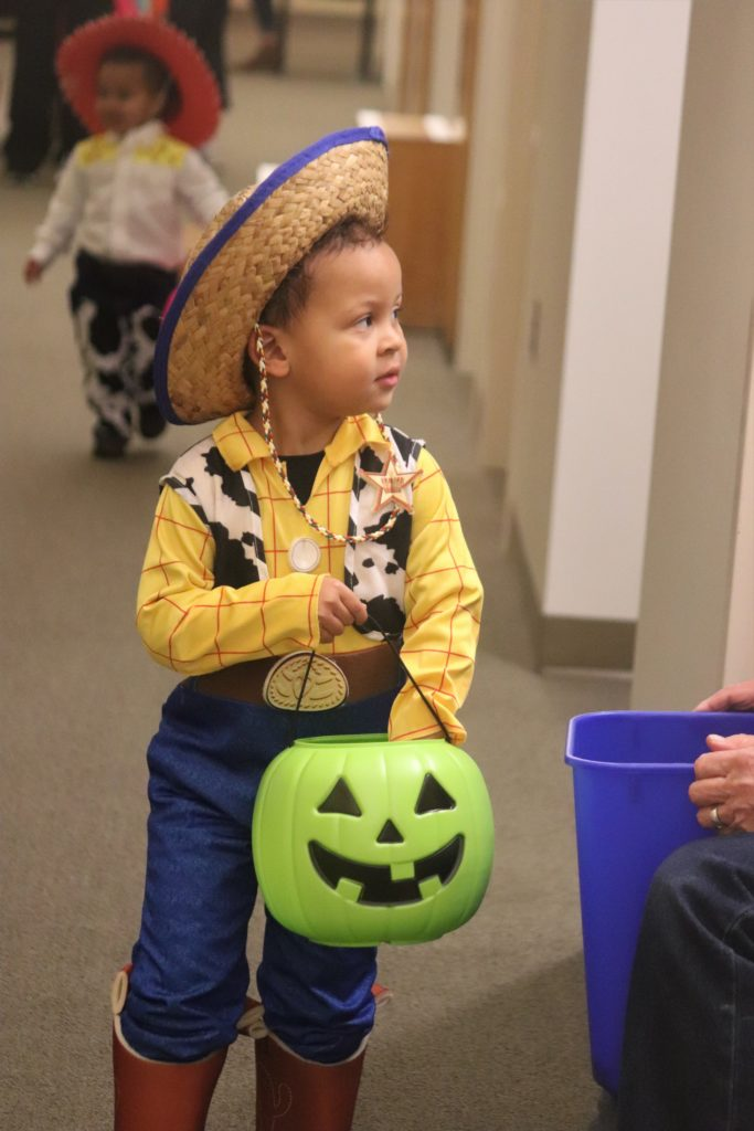 child in woody costume from toy story
