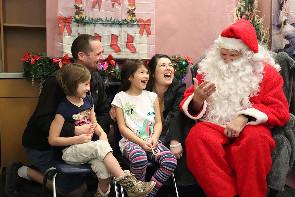 A family visits with santa