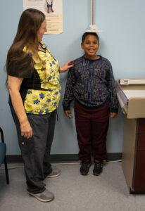 a boy and a nurse doing an exam