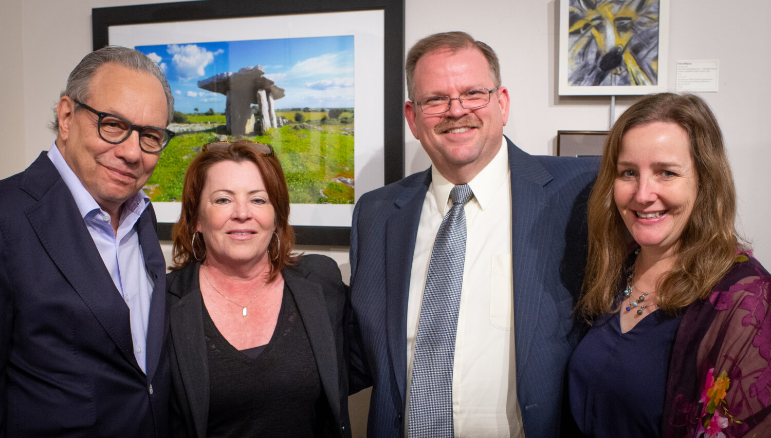 Kathleen Madigan and Lewis Black pose with MU chancellor Alexander Cartwright and his wife.