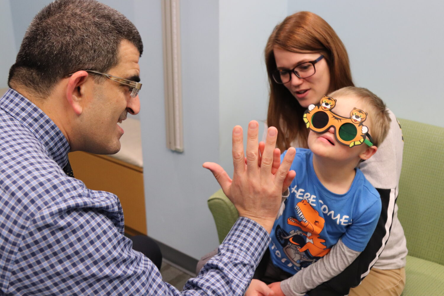 a picture of a doctor examining a child with down syndrome