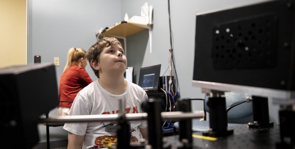 a boy has his eye gaze tracked for a research project