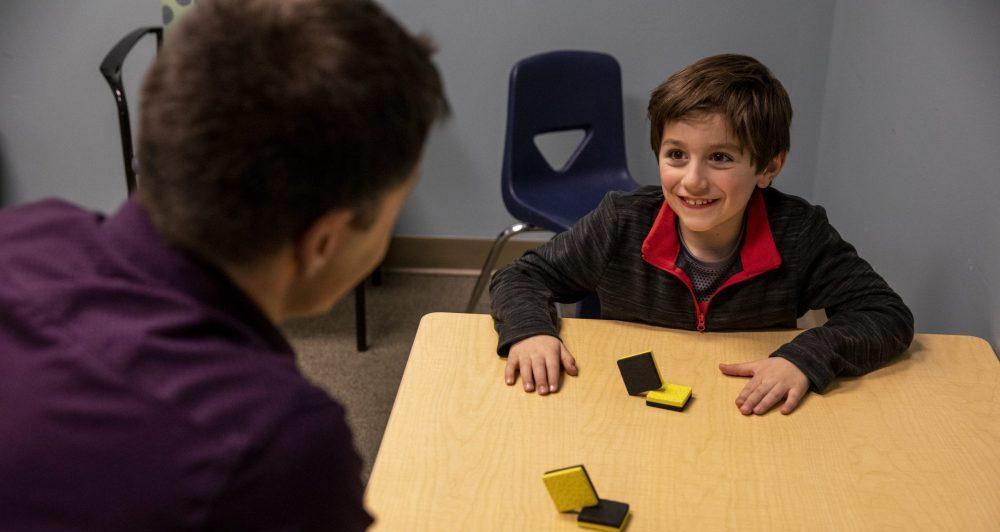 a neuropsychologist evaluates a child