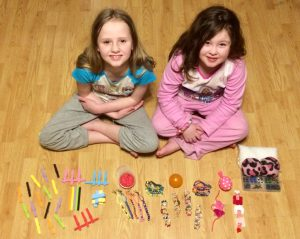 a picture of vanessa and leah clevenger showing off their merchandise